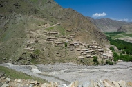 A village clinging to steep and rockfall prone slopes, to avoid floods down at the valley bottom