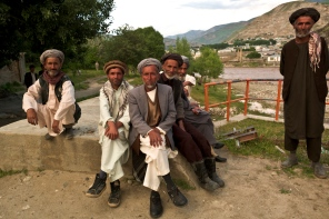 Men enjoying their evening chat down by the river in Fayzabad