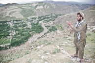 A man shows what he considers as signs of slope movements at Turgani